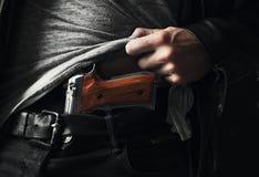 A hidden gun under the shirt Royalty Free Stock Image