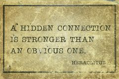 Hidden Heraclitus. A hidden connection is stronger than an obvious one - ancient Greek philosopher Heraclitus quote printed on grunge vintage cardboard Royalty Free Stock Images