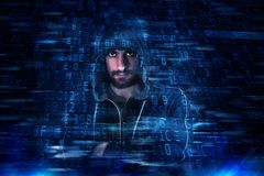 Hidden identity of a hacker. With a man with hoodie Royalty Free Stock Images