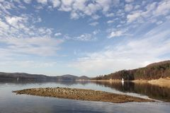 Solina hidden island. Hidden island in Solina Lake that surprisingly emerges when the water level is lower. Solina Lake is an artificial lake in the Bieszczady stock photos
