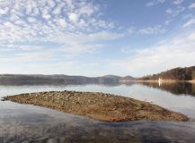 Solina episodic island. Hidden island in Solina Lake that surprisingly emerges when the water level is lower. Solina Lake is an artificial lake in the Bieszczady stock images