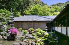 Japanese zen garden in Koshoji temple, Uji, Japan. Hidden Japanesse zen garden with lantern pagoda in Koshoji temple, Uji, Japan. Mountains on the background Royalty Free Stock Photos