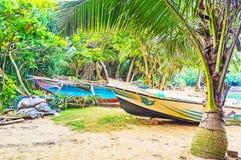 The hidden Jungle Beach. The tiny beach, hidden among the jungles of Rumassala mount, with fishing and pleasure boats, Unawatuna, Sri Lanka royalty free stock photo