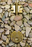 Hidden key. Key emerging from gravel, macro image Stock Photo