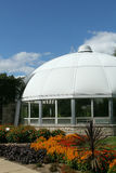 Hidden Lake Gardens Conservatory. On a fall day Tipton Michigan blue sky white dome bright bold annual flowers stock photography