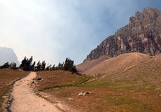Free HIDDEN LAKE HIKING TRAIL ON LOGAN PASS UNDER CIRRUS CLOUDS DURING THE 2017 FALL FIRES IN GLACIER NATIONAL PARK IN MONTANA USA Royalty Free Stock Photography - 105751617