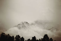 Hidden Uncompahgre Mountain Peak. A high altitude image of a 14,000 foot mountain peak surrounded by clouds Stock Image