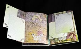 Hidden page on a third spread of a small handmade photoalbum stock image