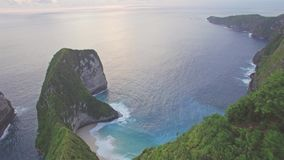 Hidden Paradise Beach Nusa Penida Indonesia Aerial 4k. Aerial footage of a hidden paradise beach in Nusa Penida island close to Bali, Indonesia stock video footage