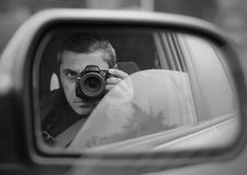 Hidden photographing. Man conducts the hidden photographing with the car royalty free stock photography