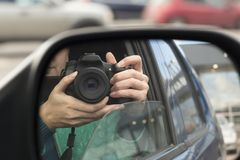 Hidden photographing. Reflection in car mirror royalty free stock photos