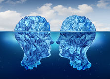Hidden Relationship. And secret partnership as two icebergs shaped as human heads face to face concealed underwater as a clandestine meeting Stock Photography