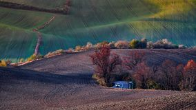 A hidden road in the picturesque green hills, a good option for a screensaver or wallpaper. South Moravia. Czech Republic. royalty free stock image