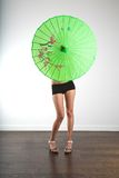 Hidden sexy woman with asian umbrella Royalty Free Stock Photo