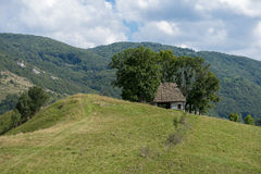 Hidden shelter. Shelter used for both cattle and their owners, high up in the mountains Stock Photo