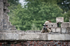 Hidden sniper. Aims his target from the top of the old building Royalty Free Stock Photo