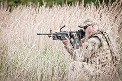 Hidden soldier on patrol royalty free stock photos