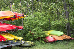 Hidden Stash. These boats, kayaks were hidden behind some bushes new the water Stock Photography