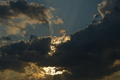 Hidden sun. Magnificent sky after a summer storm, with the sun hidden in the clouds Stock Images