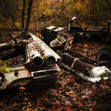 Hidden Tales. A old classic car that has been lost in the woods. This is one car taken a part Stock Image