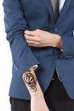 Hidden Tattoo. Young caucasian businessman revealing a hidden tattoo royalty free stock photos