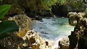 Hidden tropical lagoon UHD. UHD shot of the hidden rocky lagoon stock video footage
