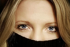 Hidden woman. Close up of a woman behind a pullover Royalty Free Stock Photo