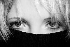 Hidden woman. Close up of a woman behind a pullover Royalty Free Stock Images