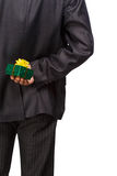 Hidding gift. Man in business suit hide a gift behind back isolated on white background Stock Photo