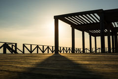 Hidding the sun. The sun hidden by a column of a pergola with balcony Stock Image