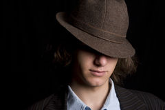 Hidding under a hat Stock Photography