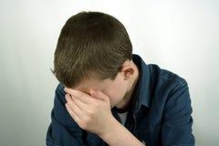 Hide. Portrait of Shy Teen Boy stock image