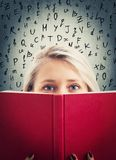 Hide behind a book stock photo