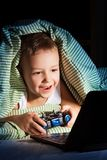 Hide from mom, play games Stock Images