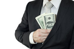 Hide money in the pocket. A well-dressed man put money in the jacket Royalty Free Stock Photo