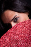 Hide and seek. Portrait of a beautiful brunette. She's hiding her face behind a hat. Portrait shot taken with 5d mark II Royalty Free Stock Images