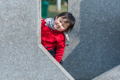 Hide and seek Chinese girl Royalty Free Stock Photo