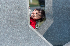 Hide and seek Chinese girl Royalty Free Stock Image