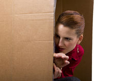 Hide and Seek. Young caucasian businesswoman acting childish Royalty Free Stock Image