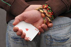 Hide trump - ace of hearts. Ace of hearts in hand - hide trump Royalty Free Stock Images