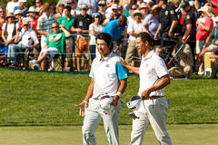 Hideki Matsuyama and Adam Scott at the Memorial Tournament Stock Images