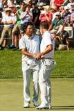 Hideki Matsuyama und Adam Scott am Erinnerungsturnier Lizenzfreies Stockbild