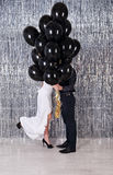 Hiding behind balloons Stock Photos