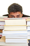 Hiding behind books Royalty Free Stock Images