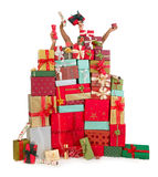 Hiding behind christmas presents Royalty Free Stock Image