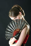 Hiding behind fan Stock Image