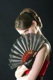Hiding behind fan Stock Image