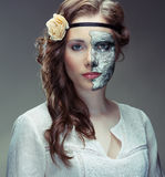 Hiding behind a mask Royalty Free Stock Photo
