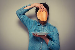 Hiding behind pancakes Stock Photography