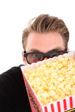 Hiding behind the popcorn bucket Stock Image